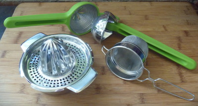 Juicers from l-r: metal hand juicer with a removable strainer; manual juice press; and fine sieve.
